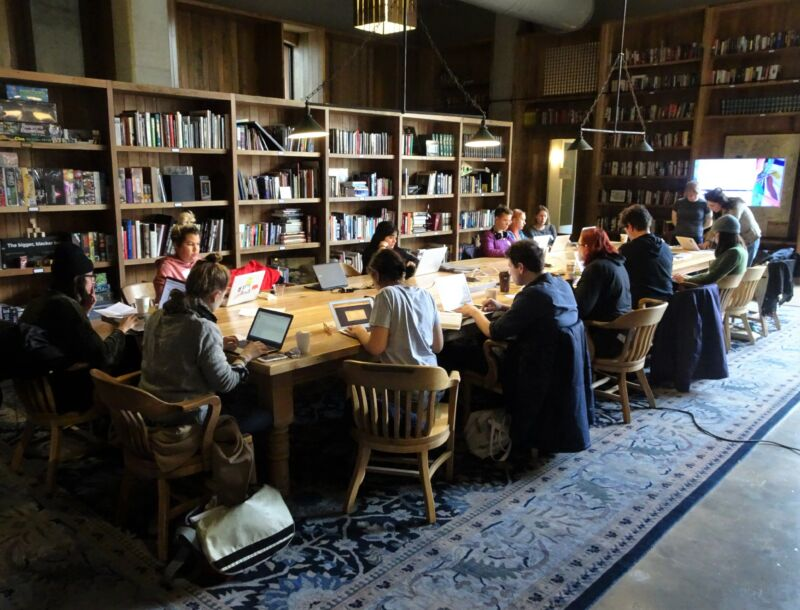 Kickstarter employees work at a library in the company's Brooklyn headquarters in 2017.