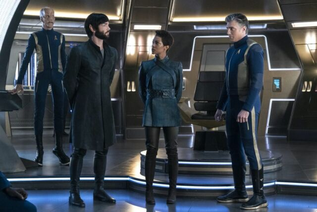 First Officer Saru (Doug Jones), Spock (Ethan Peck), Science Specialist Michael (Sonequa Martin Green), and Captain Christopher Pike (Anson Mount) on the USS <em>Discovery</em> (NCC-1031).