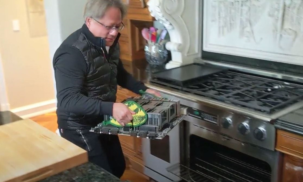 Jensen Huang of Nvidia holds the world's largest graphics card.