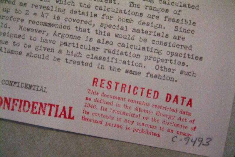 """A """"Restricted Data"""" classification stamp on a document from the US Atomic Energy Commission in the early 1950s. The document pertains to the classification of opacity calculations that were part of the work on the hydrogen bomb. The document is no longer classified and is available in the US National Archives."""