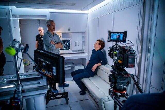 Director Neil Burger on set with Tye Sheridan, who plays Christopher.