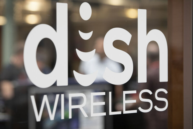 A glass door with the logo for Dish Wireless.